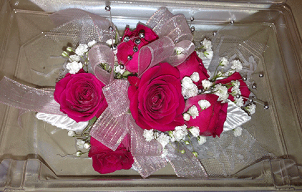 7 Red Roses Baby's Breath Corsage