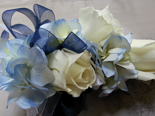 White Roses Blue Tinted Accents Corsage