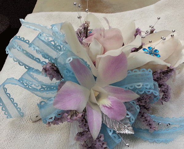 Purple tinted Orchid & Lily of the Valley Baby Blue Ribbon Corsage